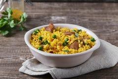 Rice z mięsnego curry'ego zielonymi grochami gotującymi Obraz Stock