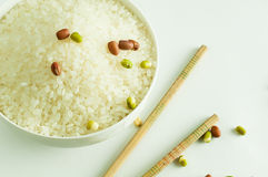 Rices. In bowl,white background Royalty Free Stock Photography
