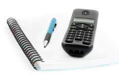 Ricevente del telefono e del taccuino con la penna Immagine Stock