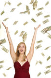 Rich. Beautiful blond in red dress on white backgrond with hundred and twenty dollars bills falling around her and a surprised look on her face Stock Photo