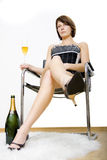 Rich. Sucess rich glamour girl sitting and drinking champagne royalty free stock photo