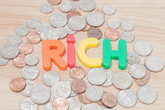 Rich alphabet with various US coins Stock Photography