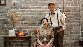 Rich Asian senior couple vintage fashion in luxury house royalty free stock image