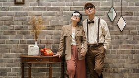 Rich Asian senior couple vintage fashion in luxury house royalty free stock images