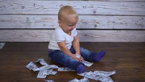 Baby with money hd. Rich baby with money hd stock video footage
