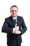 Rich banker wearing expensive suit and goggles. While fixing shirt sleve royalty free stock image