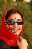 Rich and beautiful Indian woman. A portrait of a rich and glamorous Indian woman royalty free stock photo