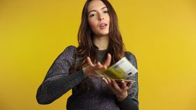 Rich beautiful woman throwing out money banknotes. Success, cash money,  savings concept. Slow motion stock footage