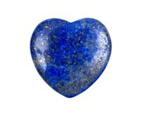 Rich blue lapis lazuli heart cabochon from Afghanistan. Isolated on white background Royalty Free Stock Photography