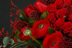 Rich bouquet of chic red roses. Сolorful rich bouquet of chic red roses and other flowers royalty free stock photo