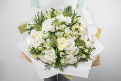 Rich bouquet flowers of different colors mixed in woman hand . Royalty Free Stock Image