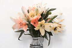 Rich bouquet of yellow, white and pink lilies Stock Photos