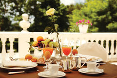 Rich breakfast on the balcony. Table set for an outdoor breakfast royalty free stock photo