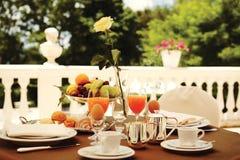 Rich breakfast on the balcony Royalty Free Stock Photo