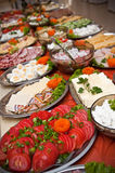Rich breakfast buffet table. Rich assortment of food spread out on breakfast buffet table Royalty Free Stock Image