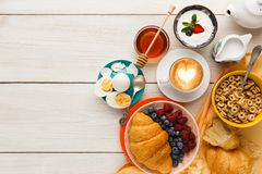 Rich breakfast menu on wooden table, copy space Royalty Free Stock Images