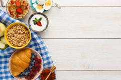 Rich breakfast menu on wooden table, copy space Stock Image