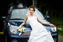 Rich bride and stylish car Stock Photos
