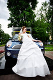 Rich bride and stylish car Royalty Free Stock Images