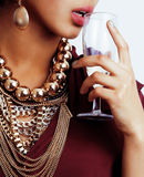 Rich brunette woman with a lot of jewelery, hispanic Royalty Free Stock Photography