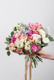 Rich bunch flowers in hand Fresh spring bouquet. Summer Background. stock photo