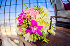 Rich bunch of pink peonies and lilac eustoma roses flowers, green leaf in the window. Fresh spring bouquet. royalty free stock image
