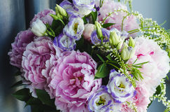 Rich bunch of pink peonies peony and lilac eustoma roses flowers. Rustic style, still life. Fresh spring bouquet, pastel Royalty Free Stock Image