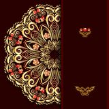 Rich burgundy background with a round gold floral pattern and place for text. Royalty Free Stock Image