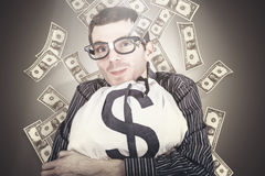Rich business man with bag loads of money Stock Photo