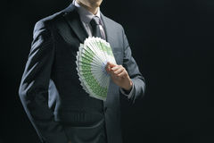 Rich Businessman. Holding a range of 100 euro banknotes royalty free stock photography