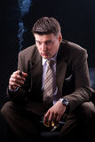 Rich businessman with cigar and drink Royalty Free Stock Photo