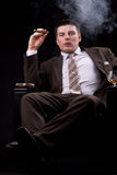Rich businessman cigars Stock Photos