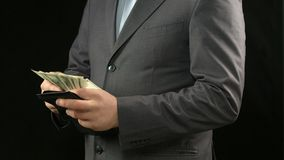 Rich businessman counting dollars in wallet, financial success, personal income Royalty Free Stock Photos