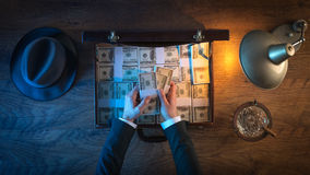 Rich businessman with dollar packs Stock Photos
