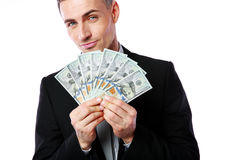 Rich businessman holding US dollars Royalty Free Stock Images
