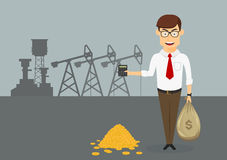 Rich businessman with money in front of oil pumps Stock Photo