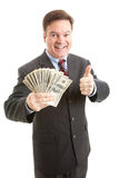 Rich Businessman Thumbsup. Wealthy, successful businessman holding a wad of cash and giving thumbsup sign.  Isolated on white Royalty Free Stock Photos