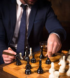 Rich businessmen playing chess Royalty Free Stock Image