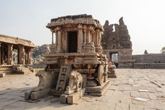 A rich carved stone chariot inside the Vittala Hindu temple in the ancient site Hampi, Karnataka, India Stock Photo