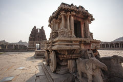 A rich carved stone chariot inside the Vittala Hindu temple in the ancient site Hampi, Karnataka, India. Asia stock photography