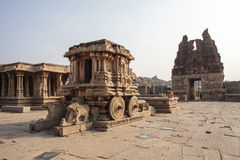 A rich carved stone chariot inside the Vittala Hindu temple in the ancient site Hampi, Karnataka, India Stock Images