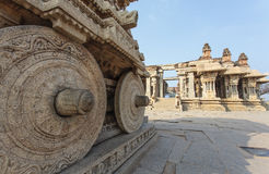 A rich carved stone chariot inside the Vittala Hindu temple in the ancient site Hampi, Karnataka, India Royalty Free Stock Image