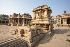 A rich carved stone chariot inside the Vittala Hindu temple in the ancient site Hampi, Karnataka, India Stock Photography