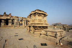 A rich carved stone chariot inside the Vittala temple in Hampi, Karnataka, India Stock Photo