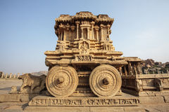 A rich carved stone chariot inside the Vittala temple in Hampi, Karnataka, India Stock Photos