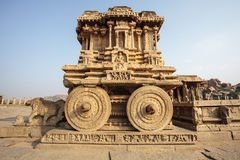 A rich carved stone chariot inside the Vittala temple in Hampi, Karnataka, India Royalty Free Stock Image