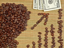 Rich Coffee. Currency buried in a heap of coffee beans, ala Rich Coffee concept Stock Images