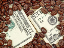Rich Coffee. Currency buried in a heap of coffee beans, ala Rich Coffee concept Stock Photo