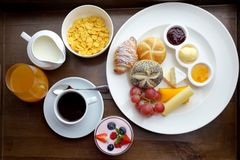 Rich continental breakfast. French crusty croissants, muesli, lots of sweet fruits and berries, hot coffee for morning. Rich continental breakfast. French crusty Stock Photography