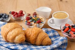 Continental breakfast with croissants and berries on natural wood Stock Images